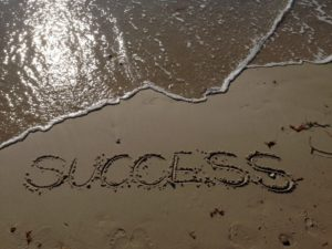 How To Fix Writer's Block-A Image of the word Success drawn into the sand on a beach Image 7 of the blog post