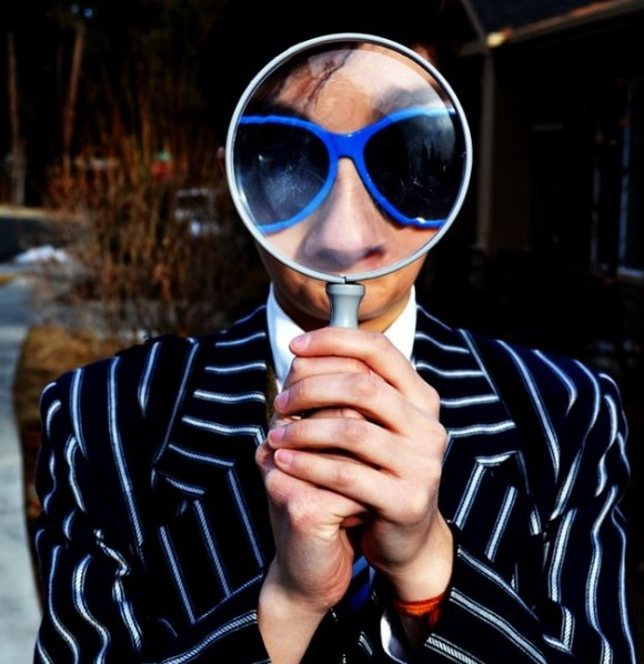 How To Overcome The Fear Of Failure And Start A Blog - image 1 for article an man with glasses looking through a magnifying glass